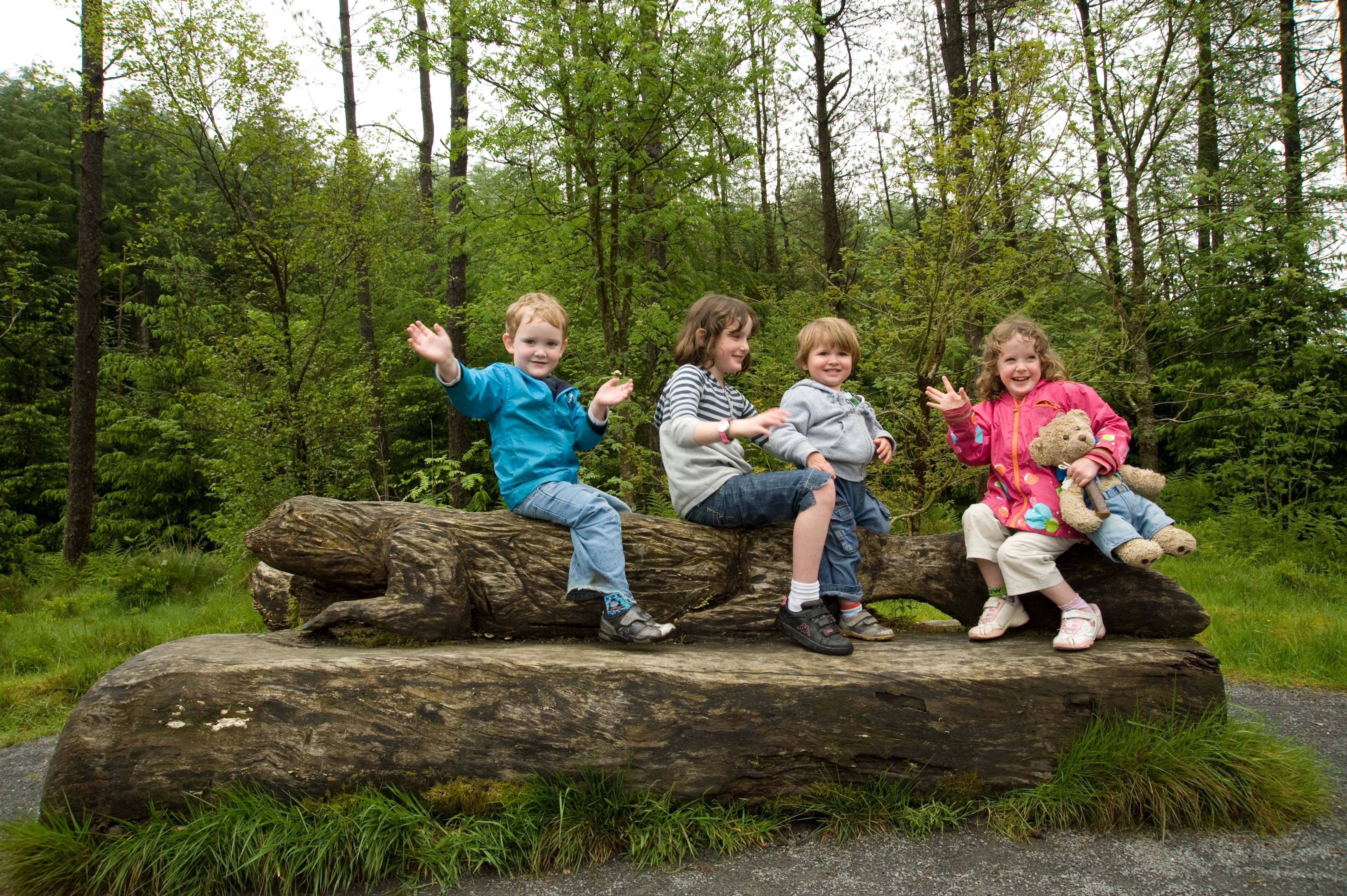 Group of children sitting on a log